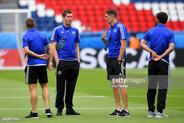 Michael McGovern and Craig Cathcart of Northern Ireland are seen during the pitch inspection prior to the UEFA EURO 2016 round of 16 match between...