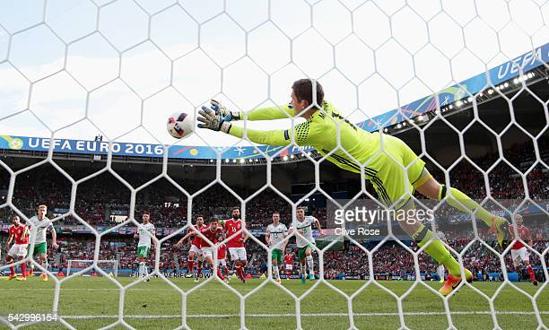 Michael McGovern of Northern Ireland saves a free kick by Gareth Bale of Wales during the UEFA EURO 2016 round of 16 match between Wales and Northern...