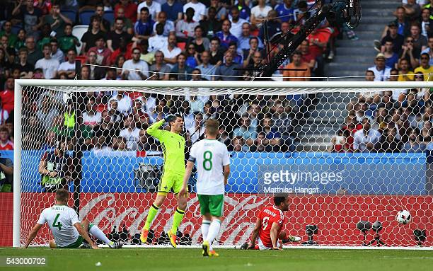 Michael McGovern of Northern Ireland shows his dejection as his team mate Gareth McAuley scores an own goal during the UEFA EURO 2016 round of 16...
