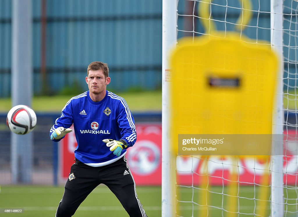 Michael McGovern of Northern Ireland takes part in a goalkeeping exercise as the international football squad train on Bangor F.C's plastic pitch on September 1, 2015 in Bangor, Northern Ireland. Northern Ireland travel to face the Faroe Islands in a Euro 2016 Group F qualifiying game in Torshavn on Friday evening.