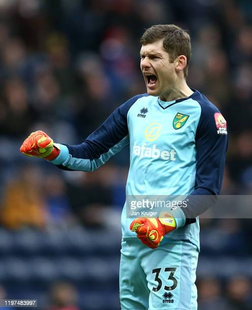 Michael McGovern of Norwich celebrates his team's first goal during the FA Cup Third Round match between Preston North End and Norwich City at...
