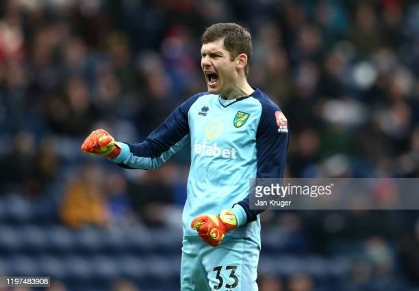 Michael McGovern of Norwich celebrateshis team's first goal during the FA Cup Third Round match between Preston North End and Norwich City at...