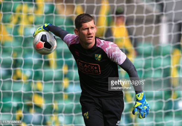 Michael McGovern of Norwich City warms up ahead of the Premier League match between Norwich City and Aston Villa at Carrow Road on October 05, 2019...