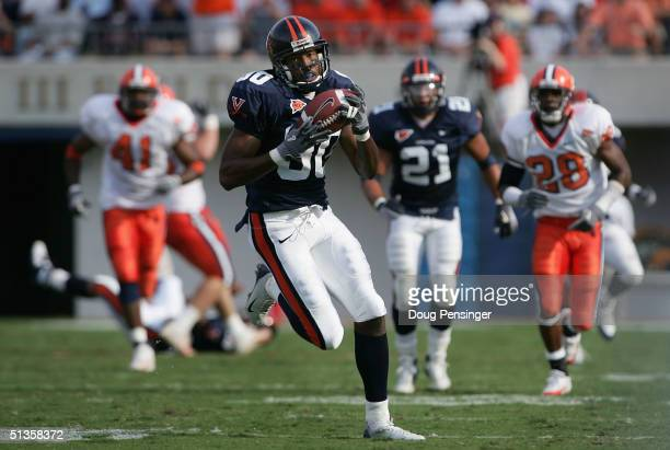 Michael McGrew of the Virginia Cavaliers makes a 50 yard recpetion in the second quarter against the Syracuse Orangemen during NCAA football at Scott...