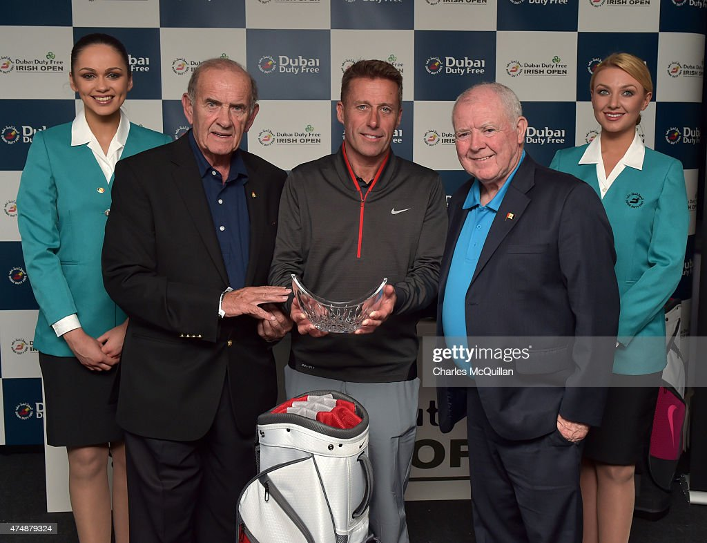 Michael McGuirk (C) is presented with his longest drive trophy by Dubai Duty Free executive vice chairman Colm McLoughlin (2nd L) and Dubai Duty Free Chairman George Horan (2nd R) at the prizegiving ceremony held in the sponsors pavillion during the Pro-Am round prior to the Dubai Duty Free Irish Open hosted by the Rory Foundation at Royal County Down Golf Club on May 27, 2015 in Newcastle, Northern Ireland.
