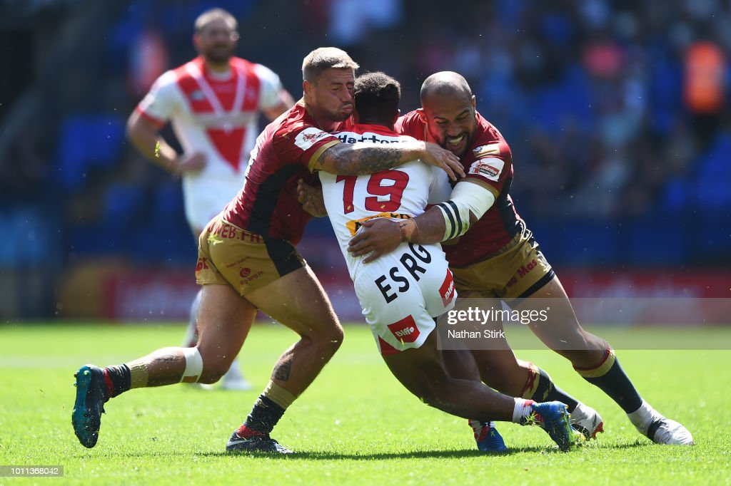 Michael MciLorum and Sam Moa of Catalans in action during the Ladbrokes Challenge Cup Semi Final match between St Helens and Catalans Dragons at Macron Stadium on August 5, 2018 in Bolton, England.