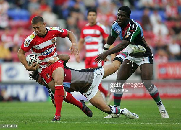 Michael McIlorum of Wigan Warriors tries to break through the harlequins RL defence during the Carnegie Challenge Cup Quarter Final match between...