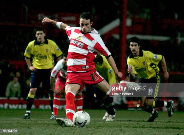 Michael McIndoe of Doncaster Rovers scores from the penalty spot during the Carling Cup match between Doncaster Rovers and Aston Villa at Belle Vue...