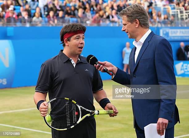 Michael McIntyre and Andrew Castle speak during the Rally Against Cancer charity match on day seven of the AEGON Championships at Queens Club on June...