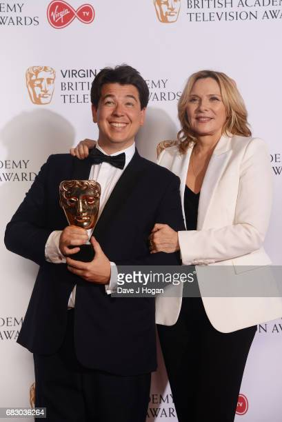 Michael McIntyre and Kim Cattrall pose with the award for Entertainment Performance in the Winner's room at the Virgin TV BAFTA Television Awards at...