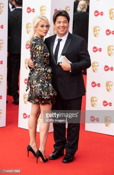 Michael McIntyre and Kitty McIntyre are seen on the red carpet during the Virgin Media British Academy Television Awards at The Royal Festival Hall...
