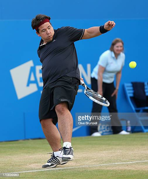 Michael McIntyre in action during the Rally Against Cancer charity match on day seven of the AEGON Championships at Queens Club on June 16, 2013 in...