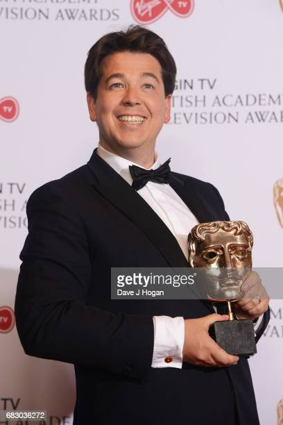Michael McIntyre poses with the award for Entertainment Performance in the Winner's room at the Virgin TV BAFTA Television Awards at The Royal...