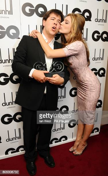 Michael McIntyre recieves a kiss from Kelly Brook after winning the Comedian award at the 2009 GQ Men of the Year Awards at the Royal Opera House,...