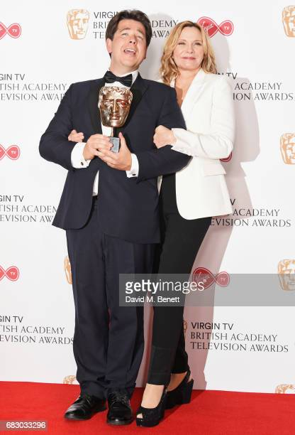 Michael McIntyre, winner of the Entertainment Performance award, and Kim Cattrall pose in the Winner's room at the Virgin TV BAFTA Television Awards...
