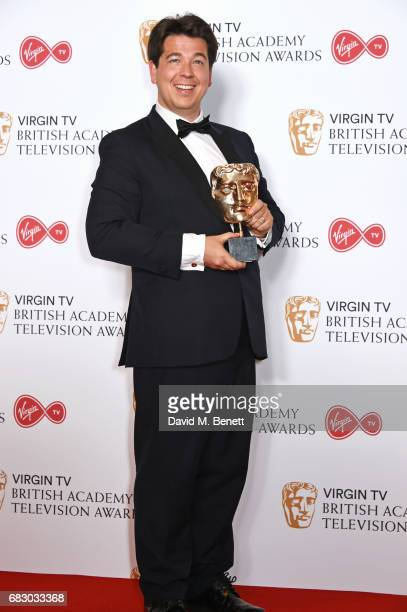 Michael McIntyre, winner of the Entertainment Performance award, poses in the Winner's room at the Virgin TV BAFTA Television Awards at The Royal...