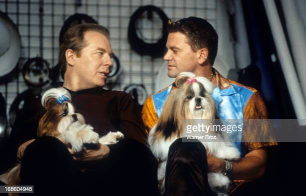 Michael McKean and John Michael Higgins both holding a dog in a scene from the film 'Best In Show', 2000.
