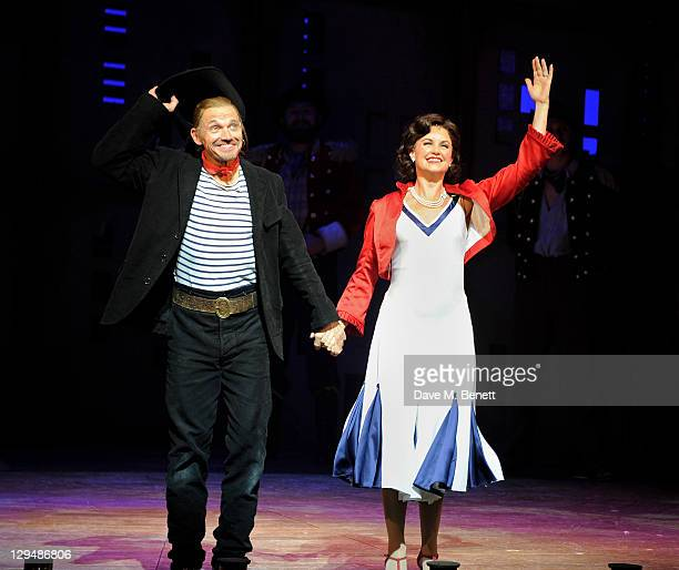 Michael McKell and Kim Medcalf bow at the curtain call during Press Night of 'Crazy For You' at the Novello Theatre on October 17 2011 in London...