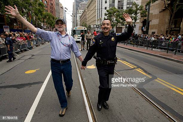 Michael Mckenna and Steve Lau take part in the 38th Annual San Francisco Lesbian Gay Bisexual Transgender Pride Celebration Parade on Market Street...