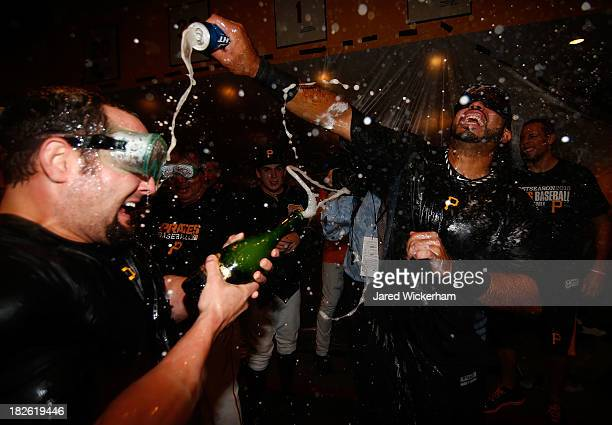 Michael McKenry and Pedro Alvarez of the Pittsburgh Pirates celebrate in the clubhouse following their 6-2 win against the Cincinnati Reds during the...