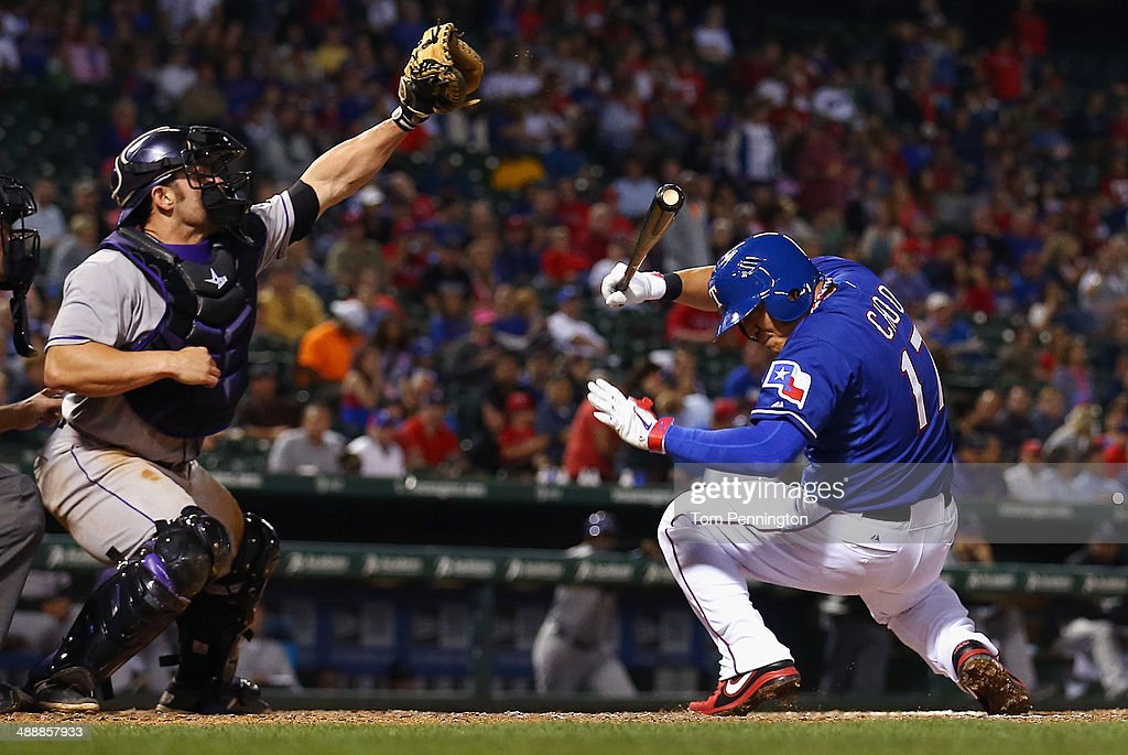 Michael McKenry #8 of the Colorado Rockies pulls in a wild pitch as Shin-Soo Choo #17 of the Texas Rangers reacts in the bottom of the seventh inning at Globe Life Park in Arlington on May 8, 2014 in Arlington, Texas.