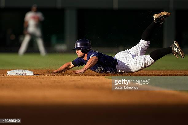 Michael McKenry of the Colorado Rockies steals second base during the second inning against the Atlanta Braves at Coors Field on June 9 2014 in...