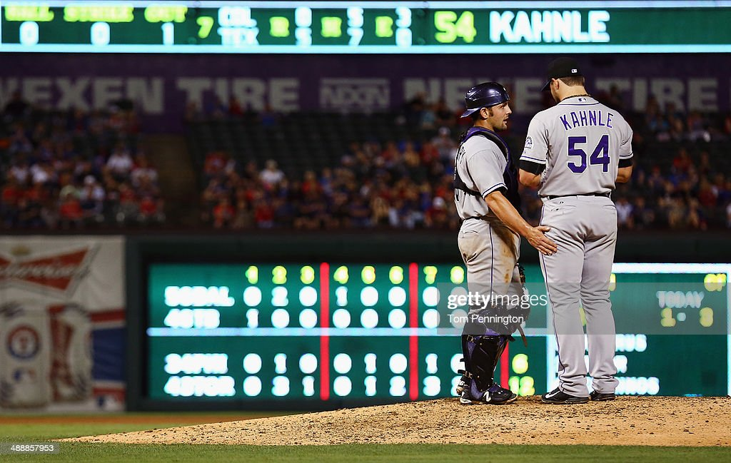 Michael McKenry #8 of the Colorado Rockies talks with Tommy Kahnle #54 of the Colorado Rockies on the mound as the Rockies take on the Texas Rangers in the bottom of the seventh inning at Globe Life Park in Arlington on May 8, 2014 in Arlington, Texas.