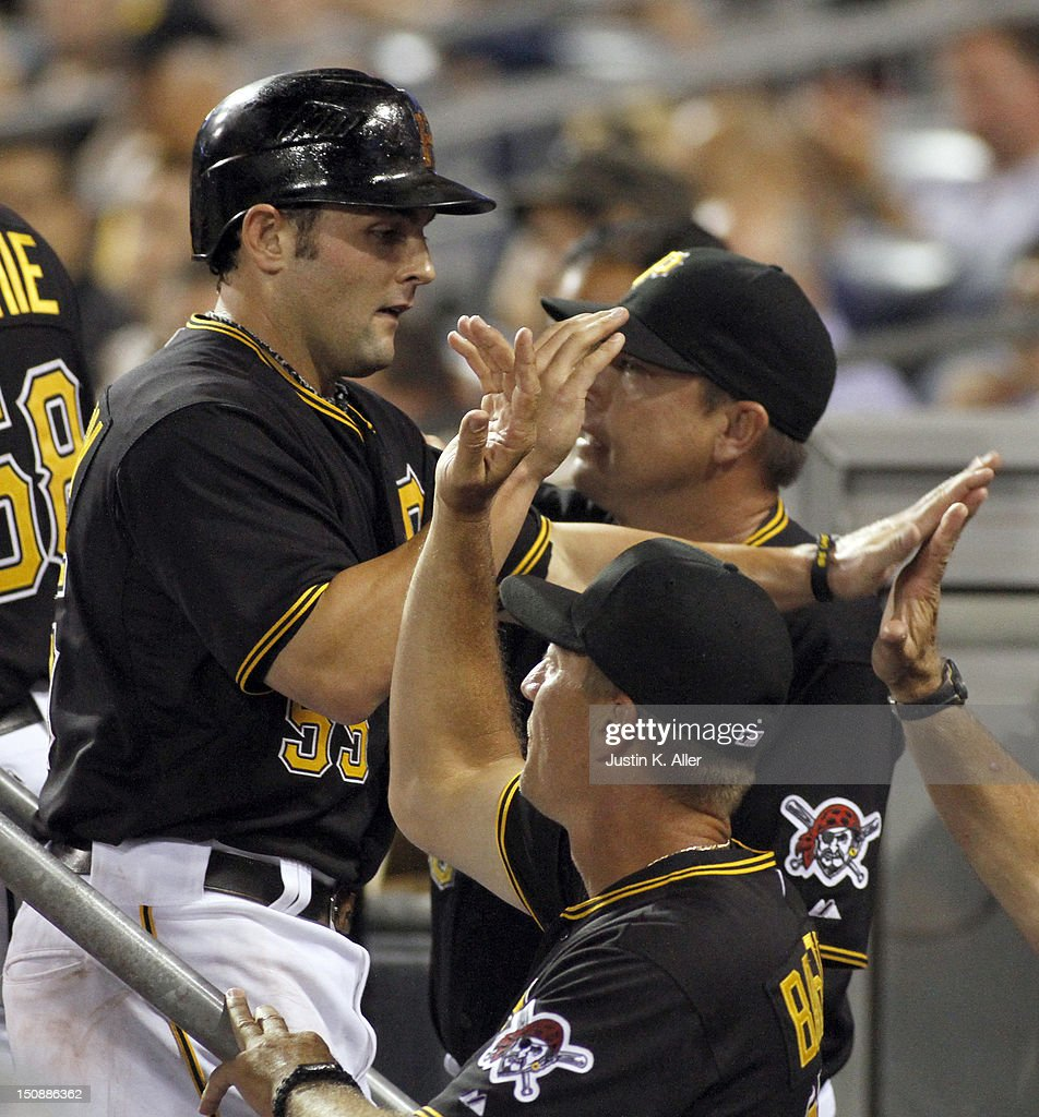 Michael McKenry #55 of the Pittsburgh Pirates celebrates after scoring on a two-RBI single in the fifth inning against the St. Louis Cardinals during the game on August 28, 2012 at PNC Park in Pittsburgh, Pennsylvania.