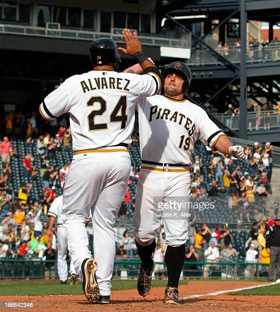 Michael McKenry of the Pittsburgh Pirates celebrates with Pedro Alvarez after hitting a tworun home run in the eighth inning tying the game at six...