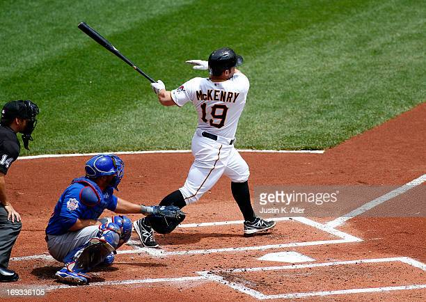 Michael McKenry of the Pittsburgh Pirates hits an RBI sinlge in the first inning against the Chicago Cubs during the game on May 23 2013 at PNC Park...