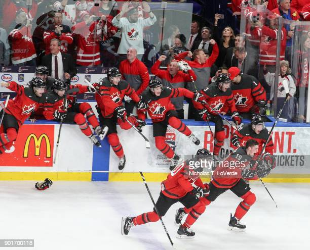 Michael McLeod of Canada and Drake Batherson lead the charge off the bench to begin the celebration as Canada defeated Sweden 31 in the IIHF World...