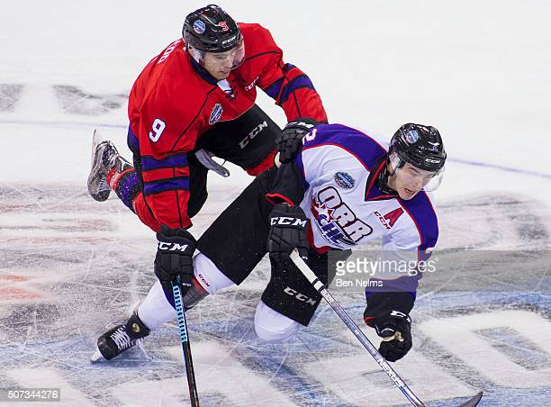 Michael McLeod of Team Cherry checks Jake Bean of Team Orr during the first period of their CHL/NHL Top Prospects game at the Pacific Coliseum on...