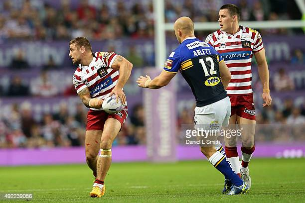 Michael Mcllorum of Wigan Warriors prepares to pass the ball during the First Utility Super League Grand Final between Leeds Rhinos and Wigan...