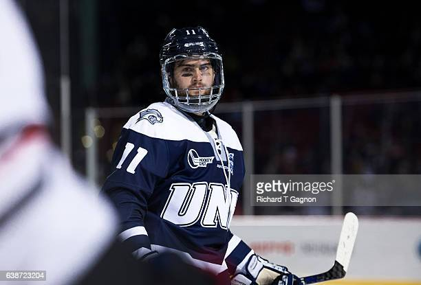 """Michael McNicholas of the New Hampshire Wildcats skates against the Northeastern Huskies during NCAA hockey at Fenway Park during """"Frozen Fenway"""" on..."""