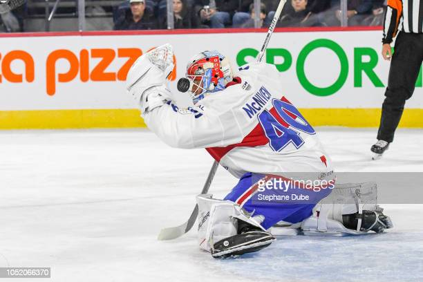 Michael McNiven of the Laval Rocket makes a helmet save against the Binghampton Devils at Place Bell on October 13 2018 in Laval Quebec