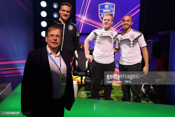 Michael 'Megabit' Bittner of Germany and Mohammed 'MoAuba' Harkous of Germany pose for a photo with Dr Rainer Koch during Day 1 of FIFA eNations Cup...