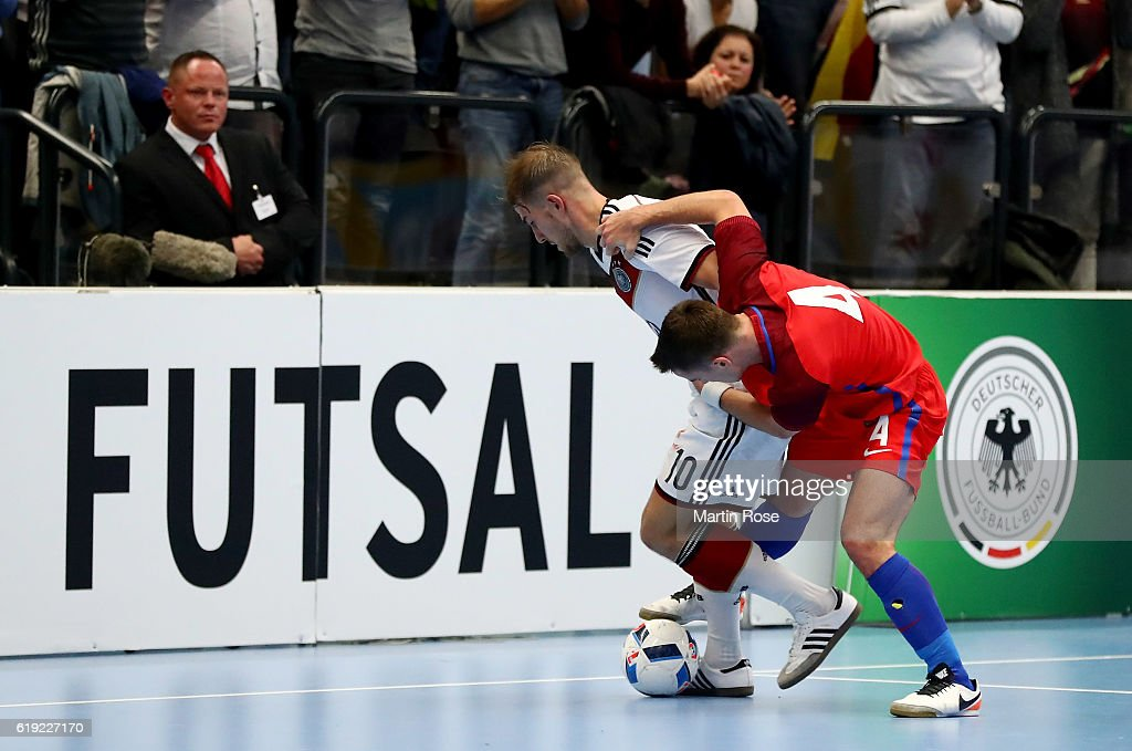 Michael Meyer (L) of Germany and Douglas Reed of England battle for the ball during the Futsal International Friendly match between Germany and England at Inselparkhalle on October 30, 2016 in Hamburg, Germany.