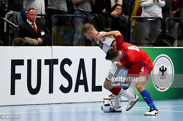 Michael Meyer of Germany and Douglas Reed of England battle for the ball during the Futsal International Friendly match between Germany and England...
