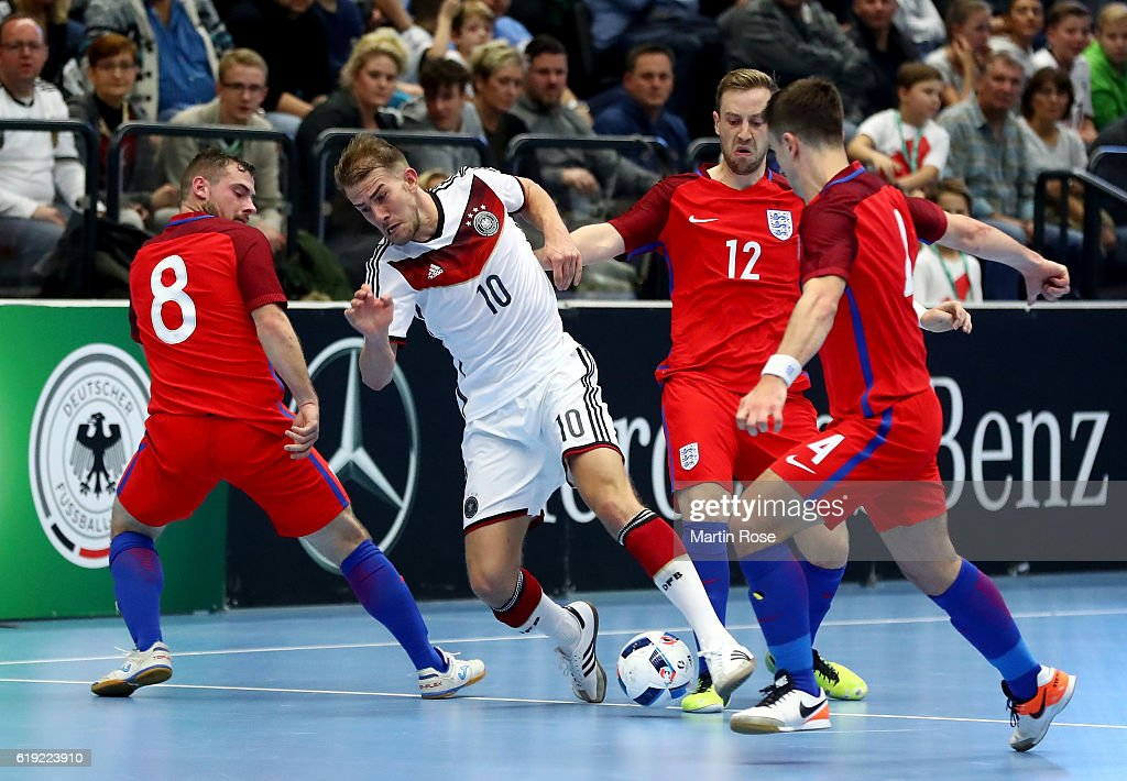 Michael Meyer (C) of Germany and Luke Ballinger #8 and Stuart Cook #12 of England battle for the ball during the Futsal International Friendly match between Germany and England at Inselparkhalle on October 30, 2016 in Hamburg, Germany.