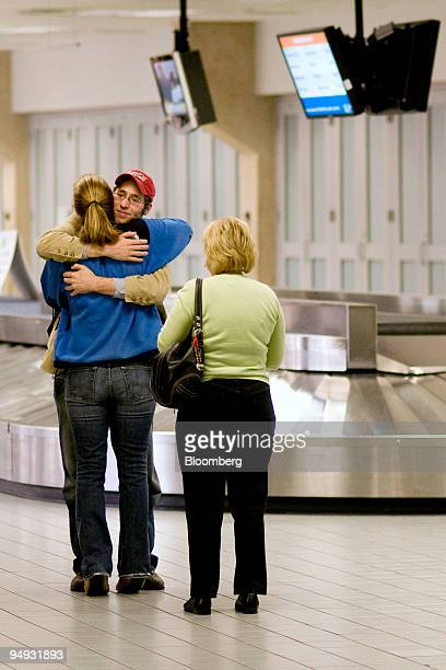 Michael Meyer second from the left hugs his sister Ashley Meyer left while their aunt Deborah Masten looks on upon Michael's arrival from Memphis at...