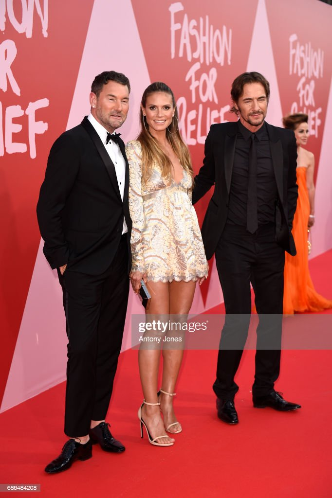 Michael Michalsky, Heidi Klum and Thomas Hayo attend the Fashion for Relief event during the 70th annual Cannes Film Festival at Aeroport Cannes Mandelieu on May 21, 2017 in Cannes, France.