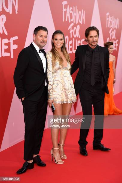 Michael Michalsky Heidi Klum and Thomas Hayo attend the Fashion for Relief event during the 70th annual Cannes Film Festival at Aeroport Cannes...