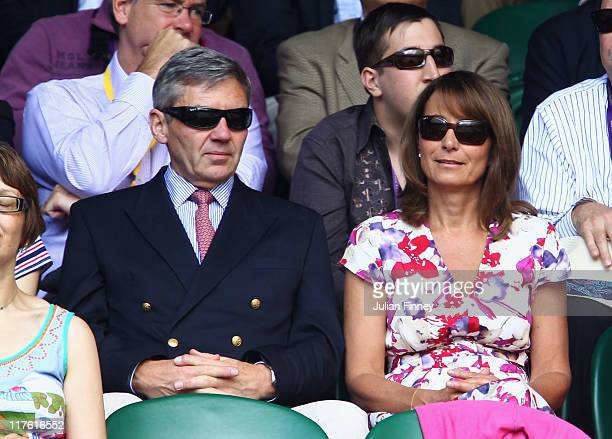 Michael Middleton and Carole Middleton attend the quarterfinal round match between Roger Federer of Switzerland and JoWilfried Tsonga of France on...