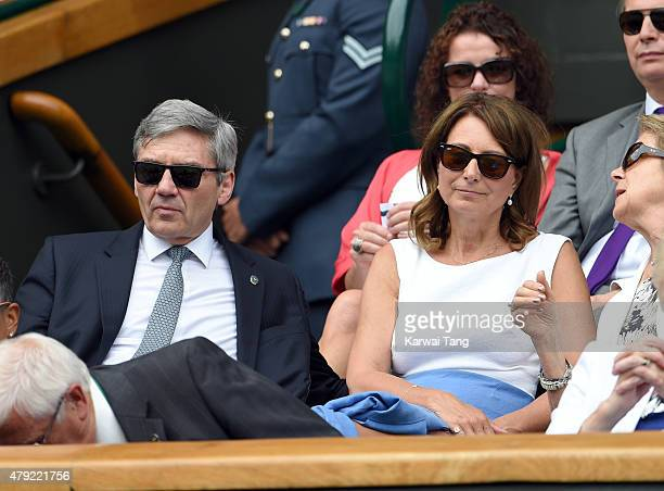 Michael Middleton and Carole Middleton attends the Christina McHale v Sabine Lisicki match on day four of the Wimbledon Tennis Championships at...