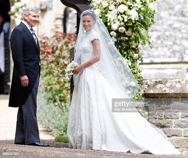 Michael Middleton and Pippa Middleton arrive at St Mark's Church for her wedding on May 20 2017 in Englefield Green England