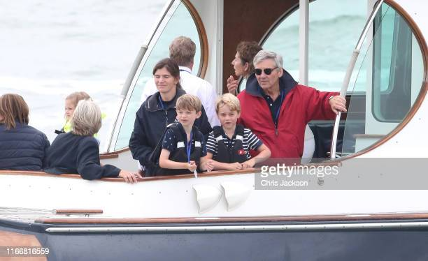 Michael Middleton and Prince George watch the inaugural King's Cup regatta hosted by the Duke and Duchess of Cambridge on August 08 2019 in Cowes...