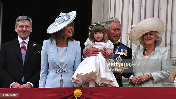 Michael Middleton Carole Middleton Prince Charles Prince of Wales holding bridesmaid Eliza Lopes and the Camilla Duchess of Cornwall on the balcony...