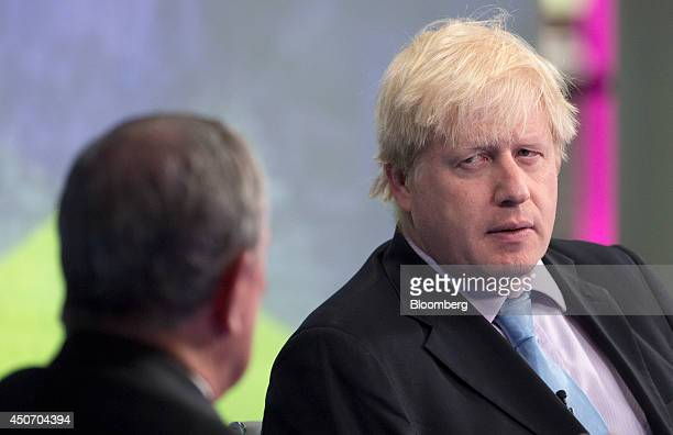 Michael 'Mike' Bloomberg Bloomberg LP founder and former mayor of New York City left listens as Boris Johnson mayor of London reacts during a...