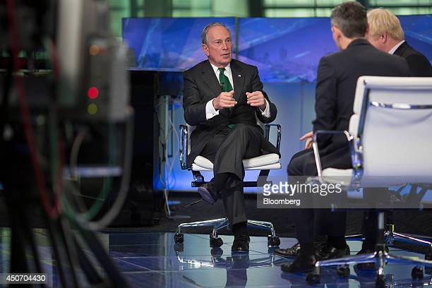 """Michael """"Mike"""" Bloomberg, Bloomberg LP founder and former mayor of New York City, left, gestures as he speaks with Bloomberg's Josh Tyrangiel,..."""