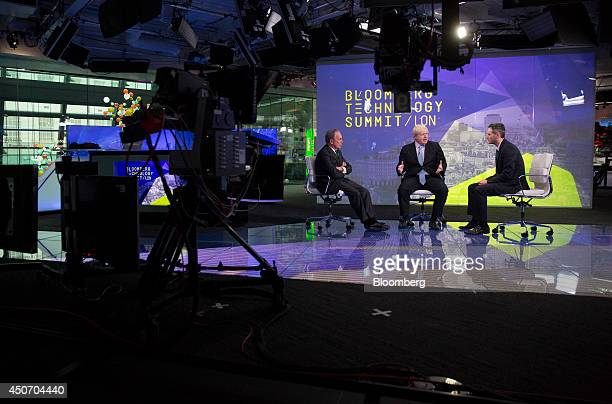 Michael 'Mike' Bloomberg Bloomberg LP founder and former mayor of New York City left and Bloomberg's Josh Tyrangiel right listen as Boris Johnson...